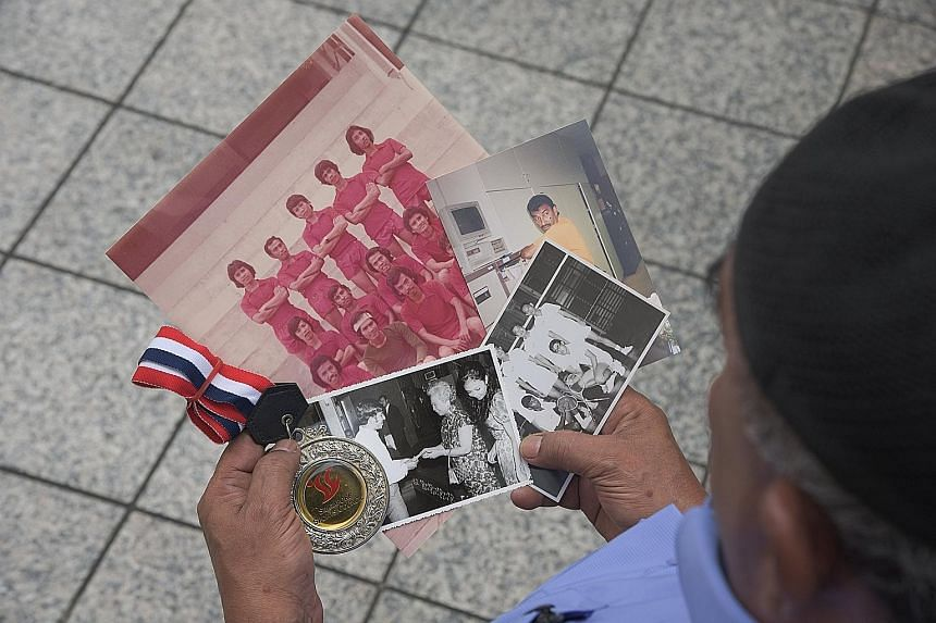 Right: Mr Mohamad Ismail Mohammad Yusof turns 71 next month but has no plans to retire yet. Below: Mr Mohamad Ismail was the bank's singles badminton champion for more than 20 years. One of his prized photos is of him receiving a badminton medal in 1