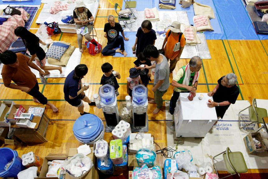 Evacuees rest at Okada elementary school, which acts as an evacuation center, in Mabi town in Kurashiki, Okayama Prefecture, Japan, on July 10, 2018.