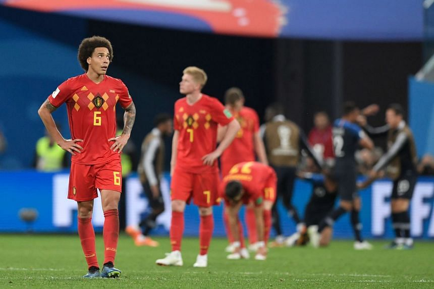 Belgium midfielder Axel Witsel (left) reacts at the end of the match.