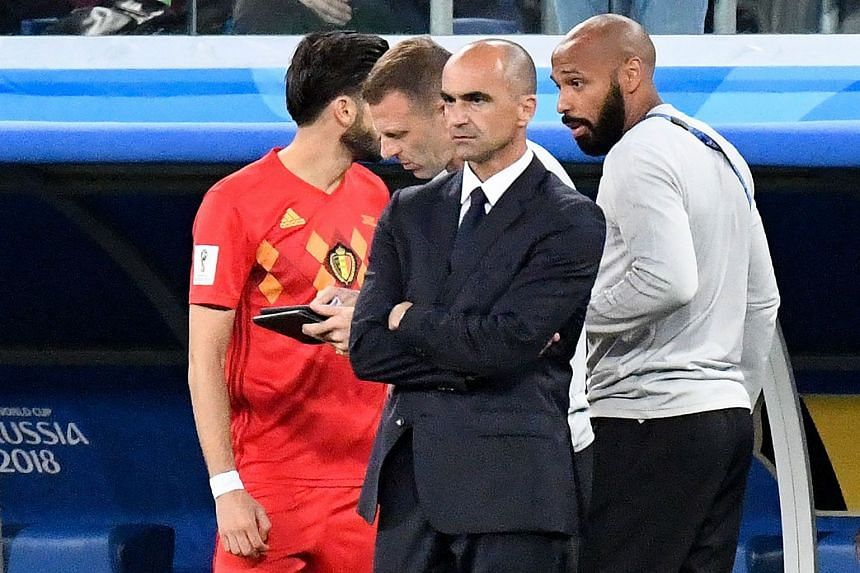 Martinez stands beside Belgium's French assistant coach Thierry Henry (right) during the match.