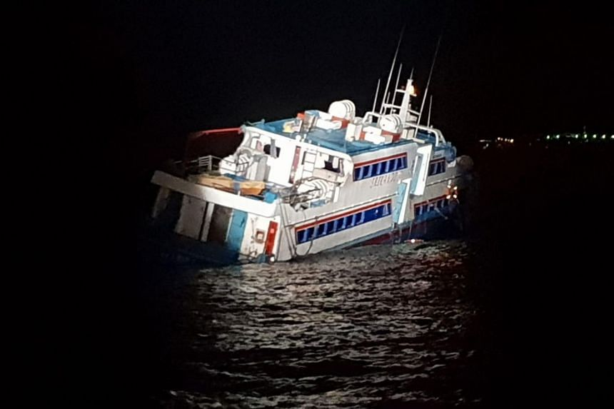 The ferry was stranded near Pulau Tekong during low tide after colliding with rocks.