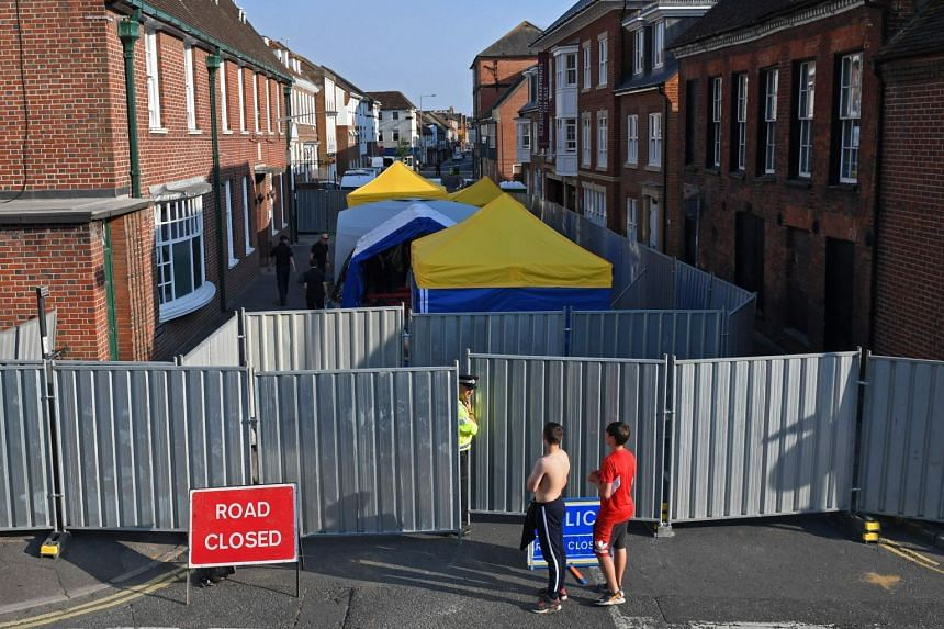 Work going on behind erected barriers in Amesbury, southern England, in connection with the poisonings.