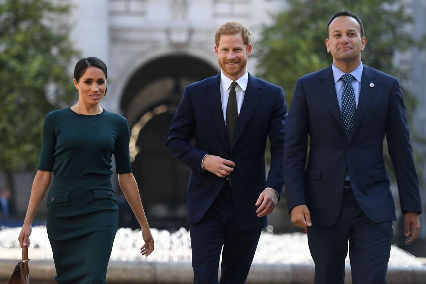 Prince Harry and his wife Meghan are greeted by Prime Minister Leo Varadkar (right) at the start of a two-day visit to Dublin.