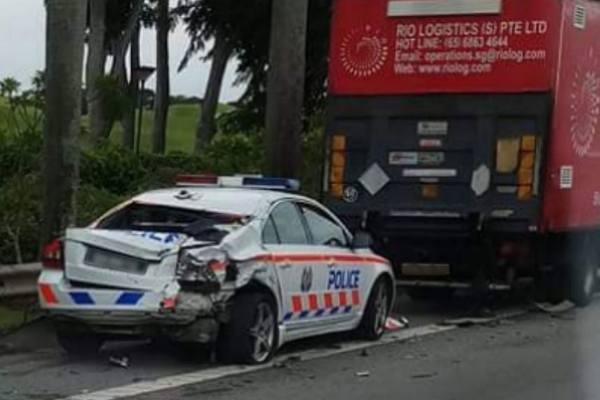 Photos posted to Facebook show a traffic police car with its rear end crushed, and the bumper and right hazard light smashed.