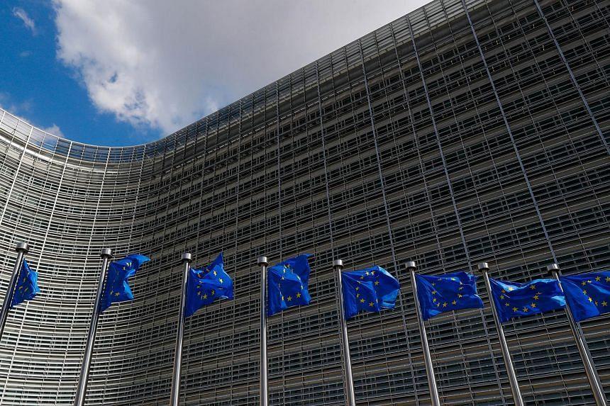 European Union (EU) flags outside the EU Commission headquarters in Brussels, Belgium, on June 20, 2018.