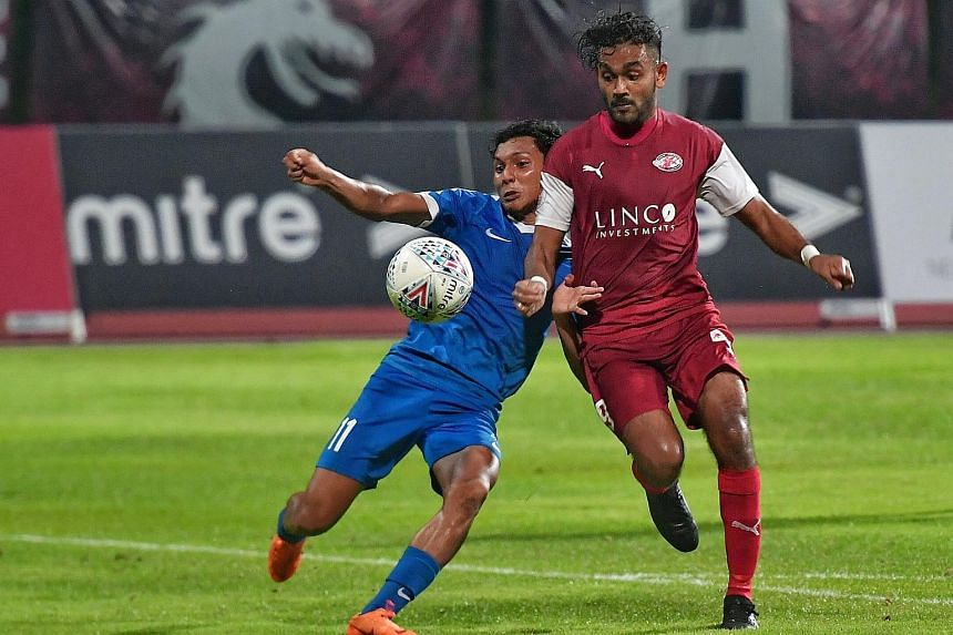 Young Lions' Zulqarnaen Suzilman (left) challenging for the ball with Home United's Faritz Hameed.