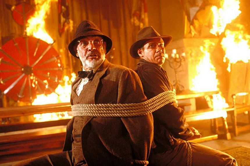 File photo of a movie still from an Indiana Jones film starring Harrison Ford (right) and Sean Connery.