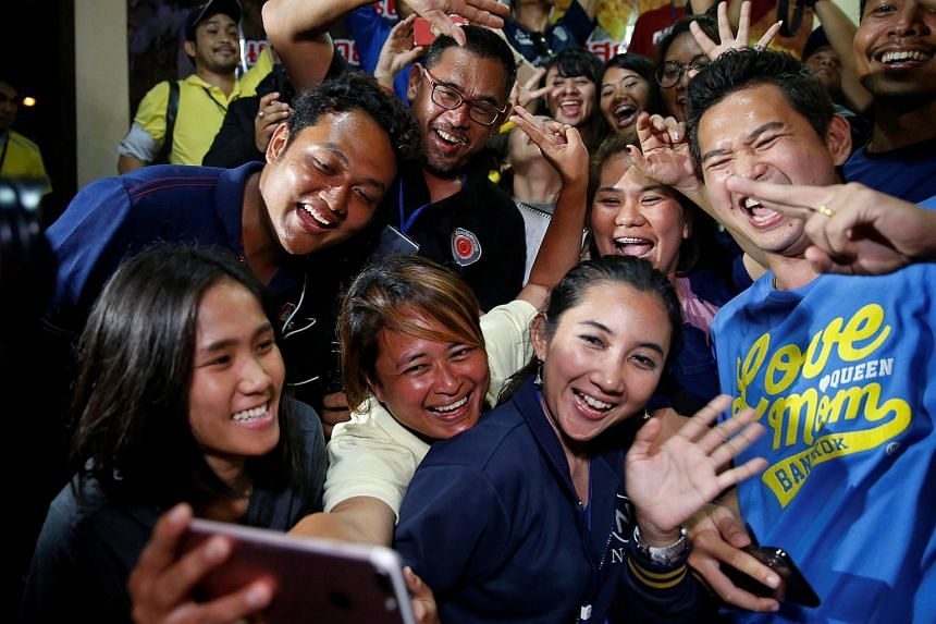 Journalists celebrate after a news conference near Tham Luang cave complex in the northern province of Chiang Rai, Thailand, on July 10, 2018.