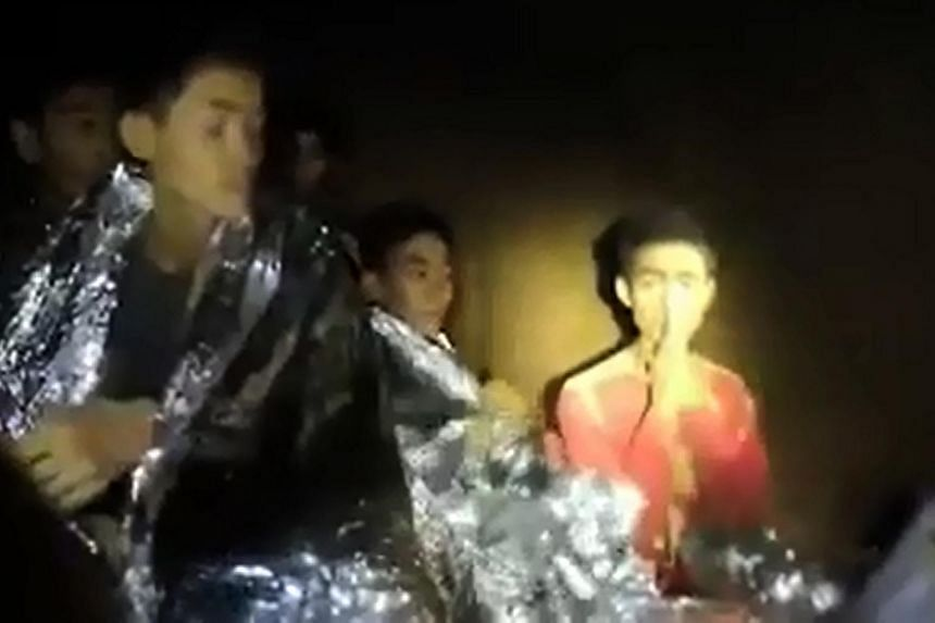 Adul Sam-on (right), a member of the Thai youth football team who was trapped with 11 other children and their coach, inside the Tham Luang cave, seen in a video screengrab taken from footage released by the Royal Thai Navy on July 4, 2018.