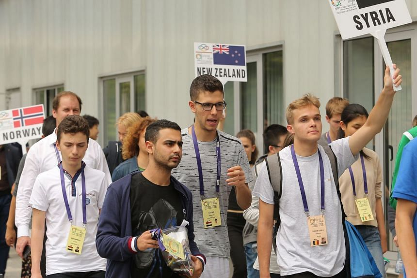 Hafez al-Assad (centre) attends the International Maths Olympics in Cluj Napoca city.