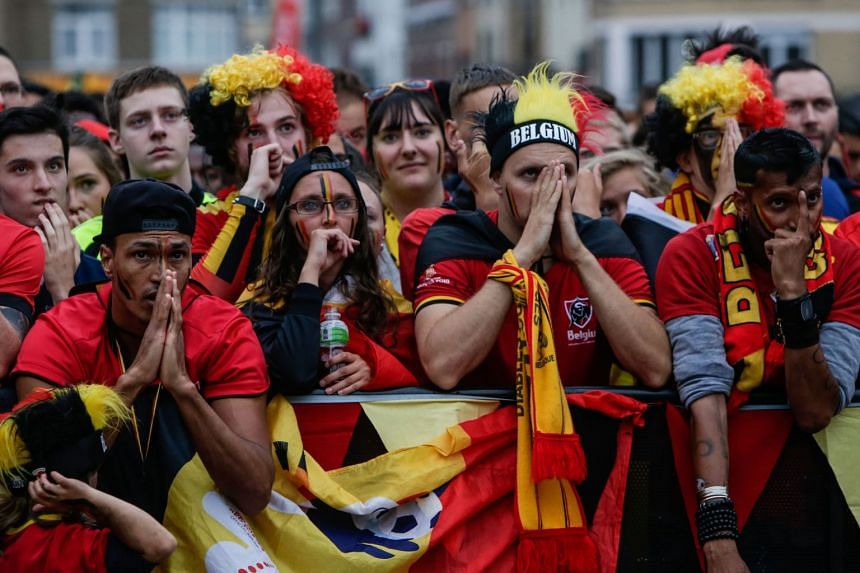 Belgium supporters gathered in Brussels react to France scoring the only goal of the match.