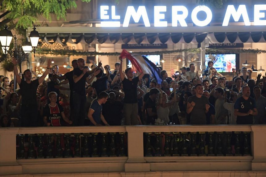 Fans of Belgium and France at El Mero Mero at Chijmes watching the match.