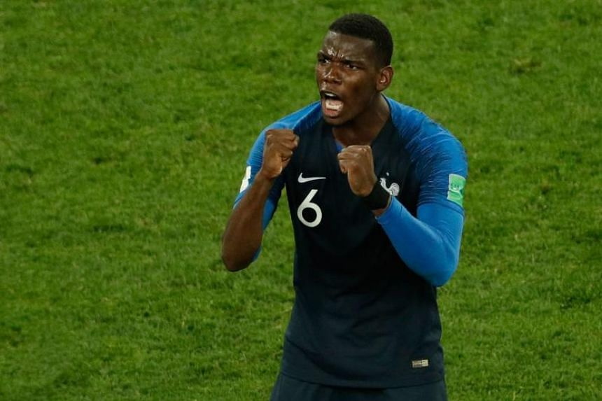 France's midfielder Paul Pogba celebrates at the end of the Russia 2018 World Cup semi-final football match between France and Belgium at the Saint Petersburg Stadium on July 10, 2018.