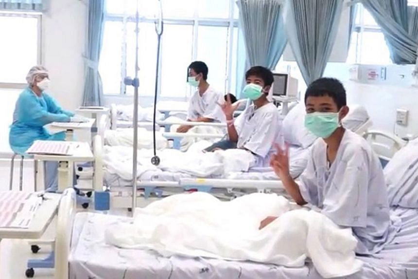 A handout photo shows the first pictures of some of the rescued boys in hospital.