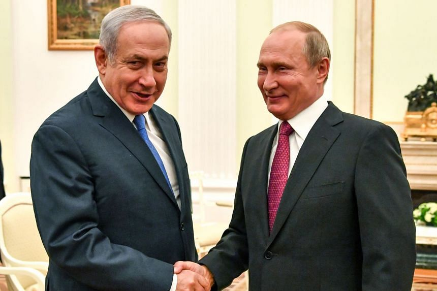 Putin (right) greeting Netanyahu at the Kremlin in Moscow.