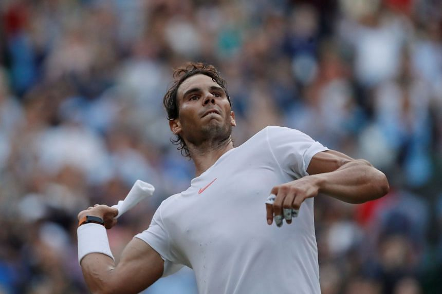 Nadal throws a sweatband into the crowd after beating Argentina's Juan Martin del Potro.