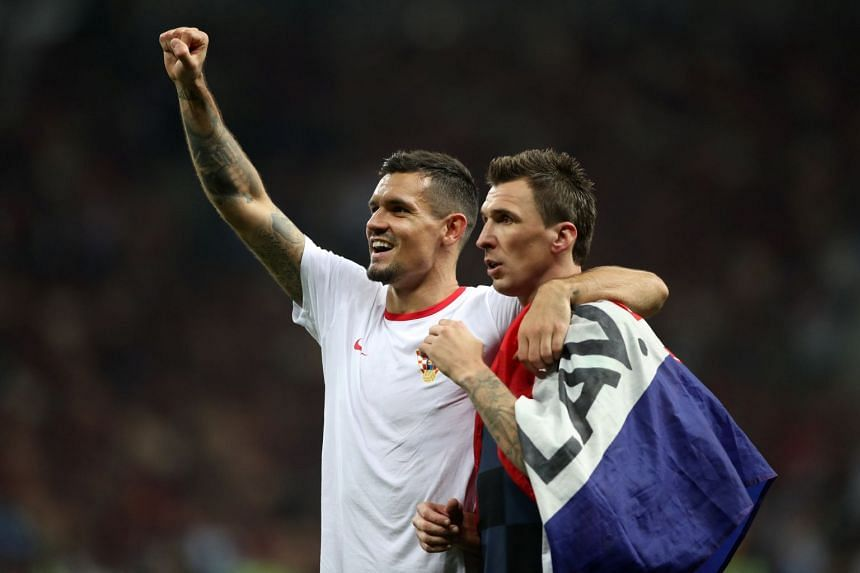 Croatia's Dejan Lovren and Mario Mandzukic celebrate after the match.