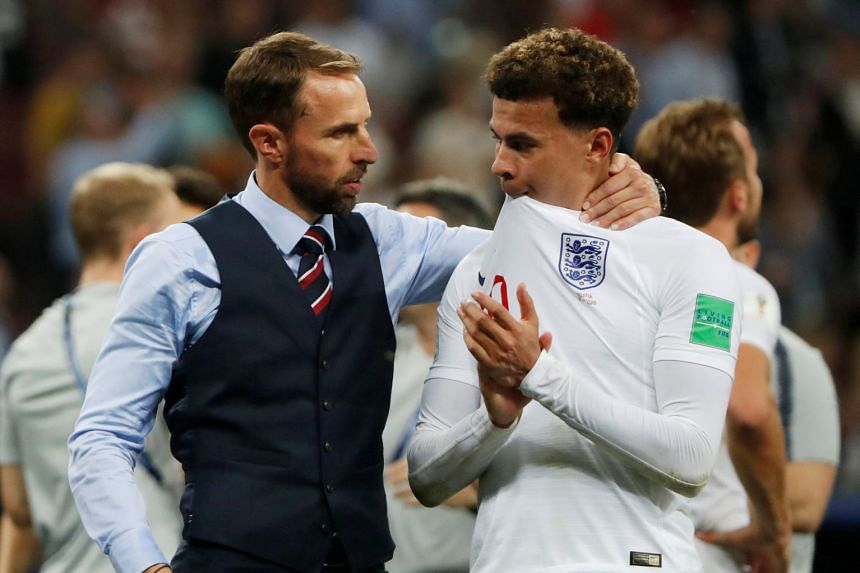 England manager Gareth Southgate consoles Dele Alli after the match.