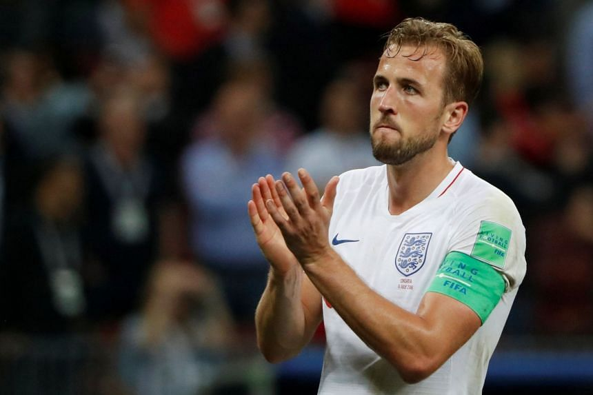 England's Harry Kane applauds their fans after the match.