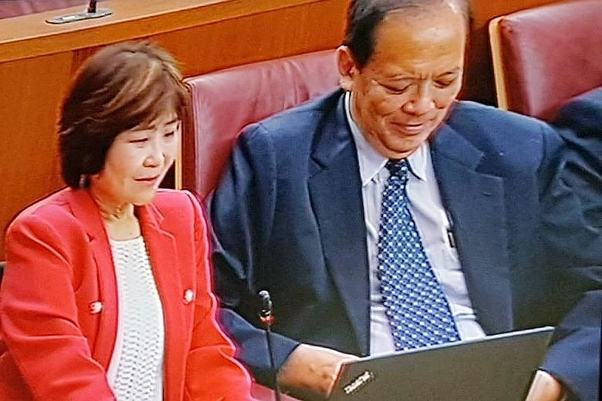 Nominated MP Chia Yong Yong, seen here with MP Charles Chong yesterday, recalled how her teachers did not treat her as inferior despite her disability.