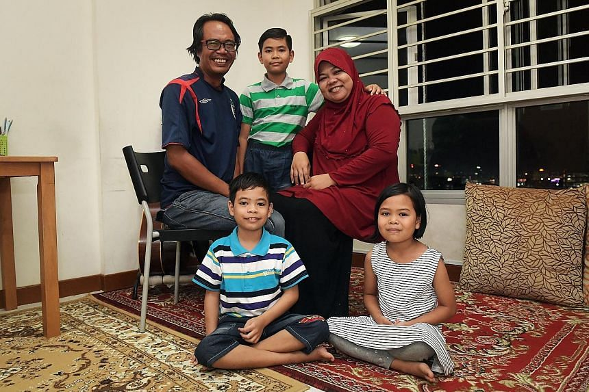 """Above: Senior Parliamentary Secretary for Education Muhammad Faishal Ibrahim said """"where we begin in life will not dictate where we end up"""". Right: Contract job worker Rahmat Mohamad, 45, and housewife Suriyati Faidi, 44, are glad that their children"""