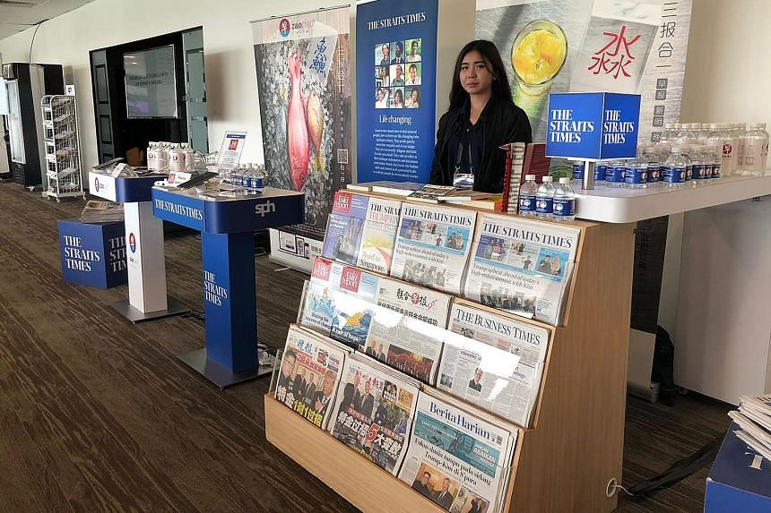 SPH's booth at the International Media Centre during the Trump-Kim summit last month. The group's digital-first strategy has been gaining ground, as both digital subscriptions and E-paper readership grew in the third quarter.
