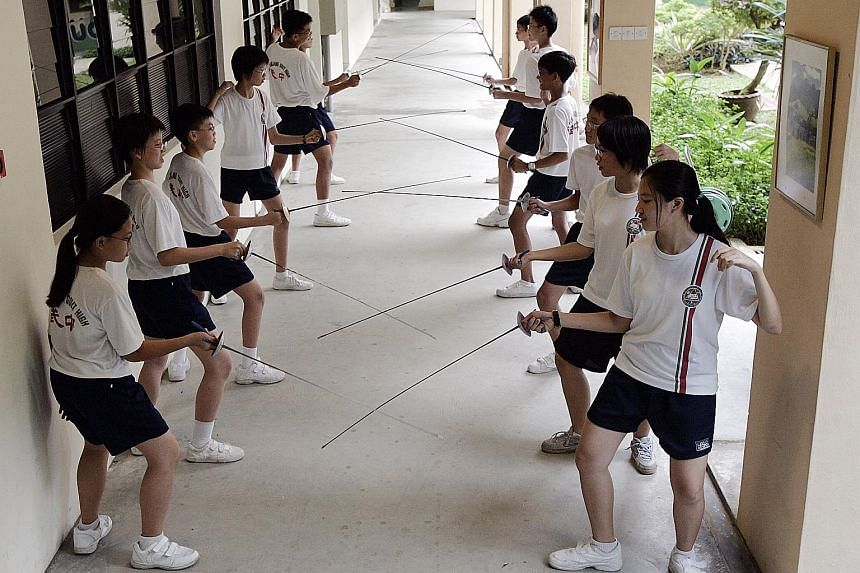 Bukit Panjang Government High students practising their fencing, one of a wide variety of activities which Education Minister Ong Ye Kung said were once seen as being available only to wealthier students, but which are now offered as CCAs.