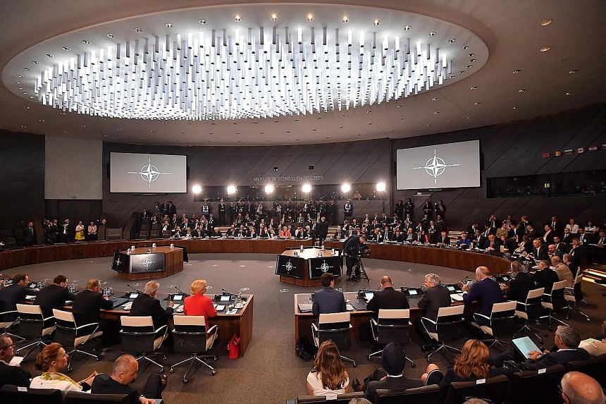 Officials on Tuesday attending the North Atlantic Council meeting during the Nato summit at its headquarters in Brussels.