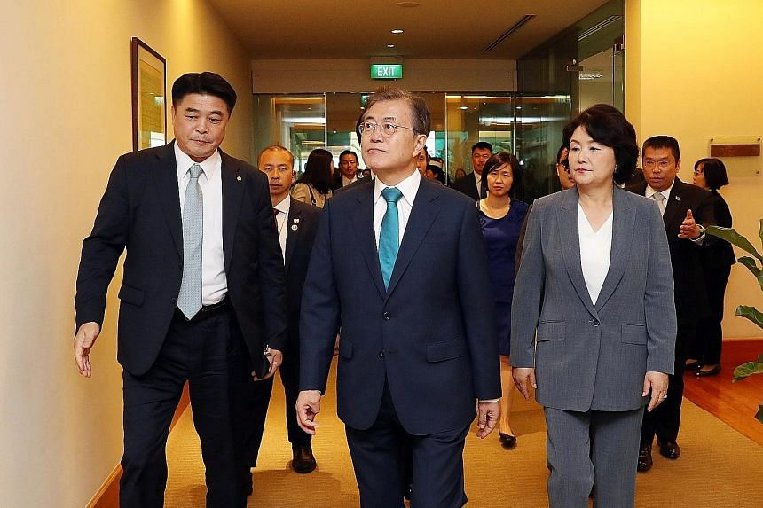 President Moon Jae-in and First Lady Kim Jung-sook arriving in Changi Airport yesterday for a state visit.