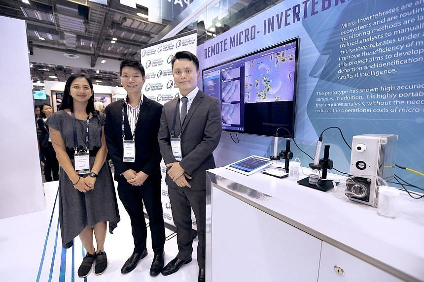 (Above, from right) Microbiologist Martin Tay who, with the assistance of senior biologist Hou Zhisheng and biologist Erica de Souza, developed software for the PUB to automatically detect insect eggs and larvae, at the agency's pavilion at Marina Ba