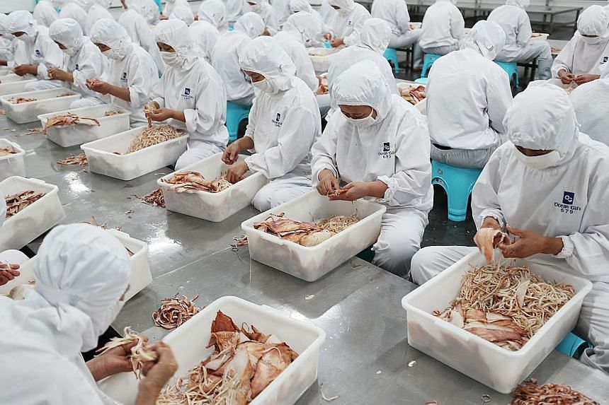 Workers sorting dried seafood for export at a factory in China's eastern Jiangsu province. IHS Markit's Asia-Pacific chief economist said in a note that the additional tariffs will hit China's export sector hard.