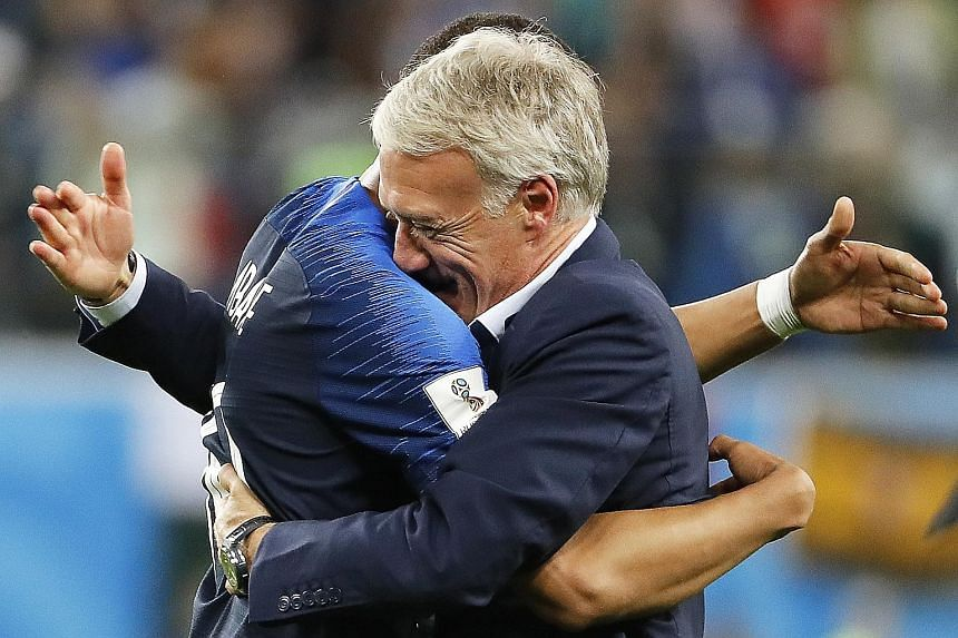 An emotional France head coach Didier Deschamps celebrating with teenage star Kylian Mbappe, after the team beat Belgium 1-0 in their World Cup semi-final in St Petersburg to enter Sunday's final in Moscow.