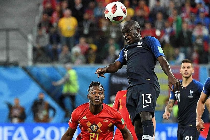 France midfielder N'Golo Kante winning the ball in Tuesday's semi-final against Belgium. At 1.68m, Kante may be one of the smallest players in Russia, but he has been colossal for Les Bleus.