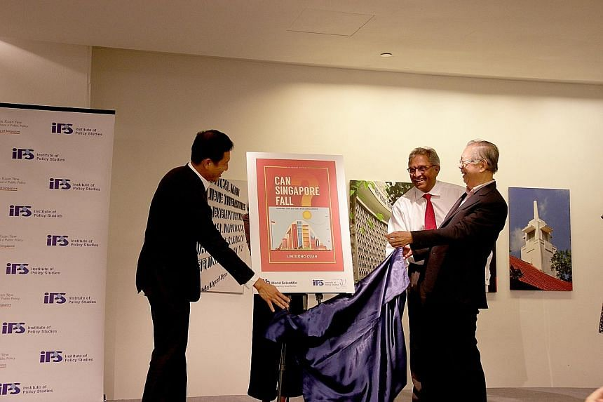 (From left) Education Minister Ong Ye Kung, Institute of Policy Studies director Janadas Devan and Mr Lim Siong Guan at the launch of Mr Lim's book yesterday.