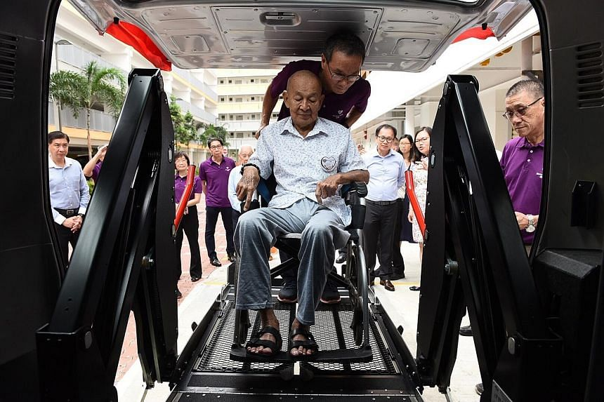 Mr Guek Chan Hong, 79, is the first to try the automatic hydraulic lifter on the refurbished Toyota HiAce bus donated to volunteer welfare organisation Blossom Seeds. In addition to the bus, ComfortDelGro has also donated $100,000 worth of medi trips