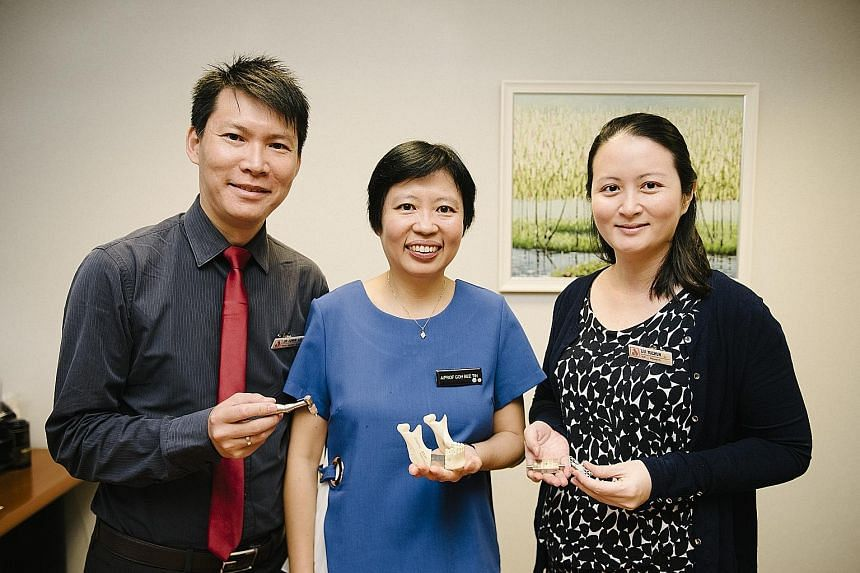National Dental Centre Singapore researchers (from left) Dr Edwin Liu, Dr Goh Bee Tin and Dr Liu Yuchun with a mock-up of the new device.