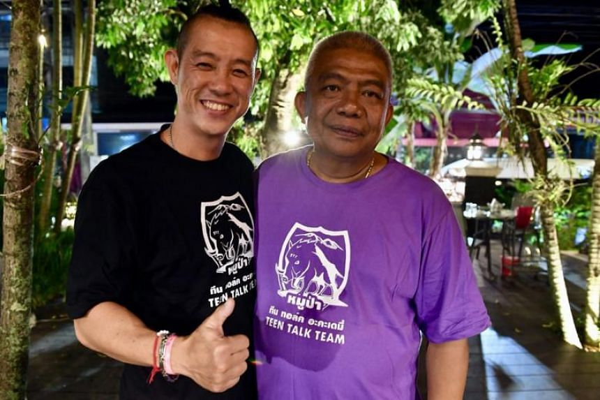 Mr Douglas Yeo (left), a Singaporean who has 26 years of recreational and salvage diving experience, with Mr Buncha Duriyapan, commander of the 37th Thai Military District in Chiang Rai, at a post-rescue celebration on July 11, 2018.