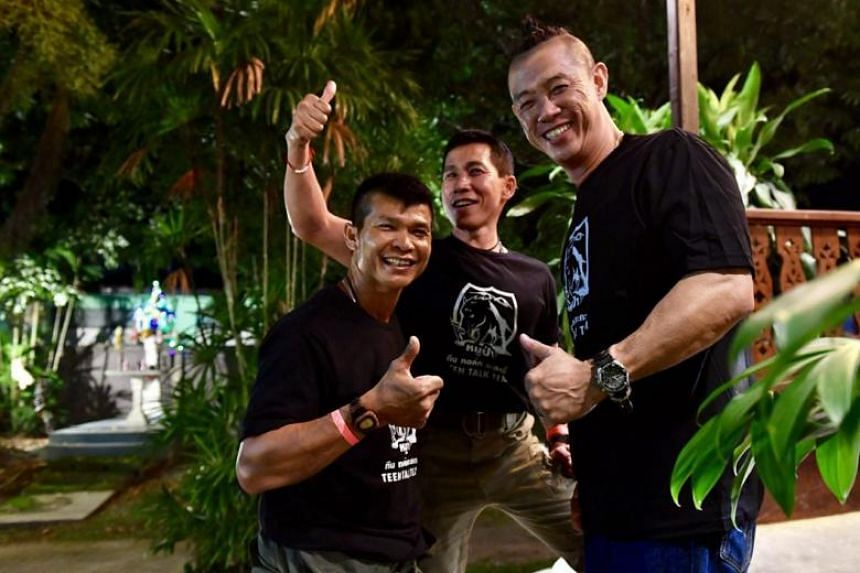 """Mr Yeo (right) with his buddy """"Joe"""" (left) and another Thai Navy Seal, who was the supervisor of the site where Mr Yeo was deployed."""