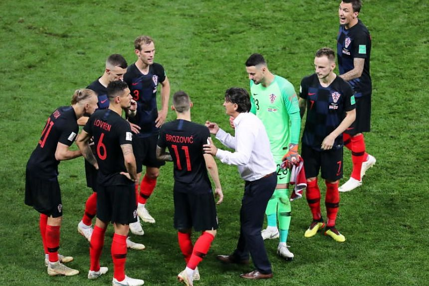Croatia's head coach Zlatko Dalic (centre right) gives instructions to his players before the extra time of the 2018 World Cup semi-final football match between Croatia and England in Moscow, Russia, on July 11, 2018.