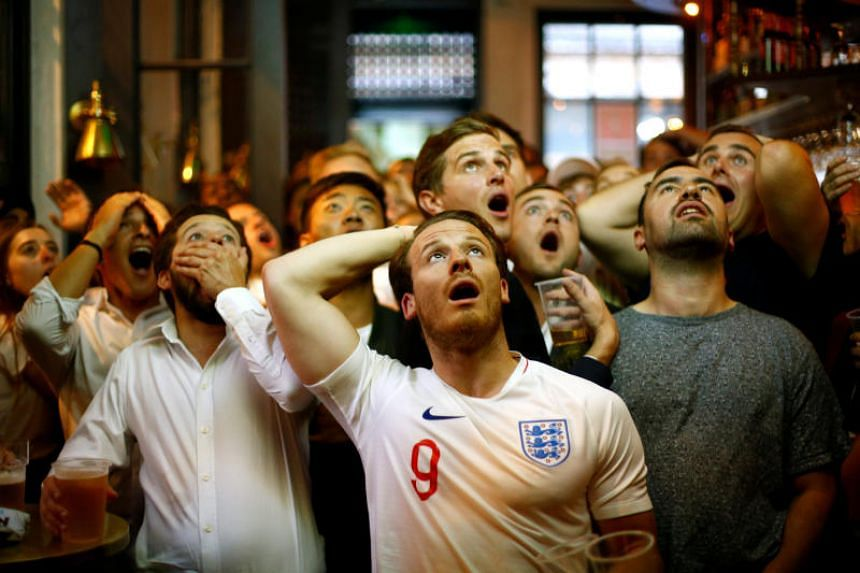 England fans react as they watch the match between Croatia and England at Trafalgar Square in London, Britain, on July 11, 2018.