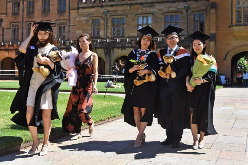Students from China posing for their graduation photos at Sydney University on Oct 12, 2017.