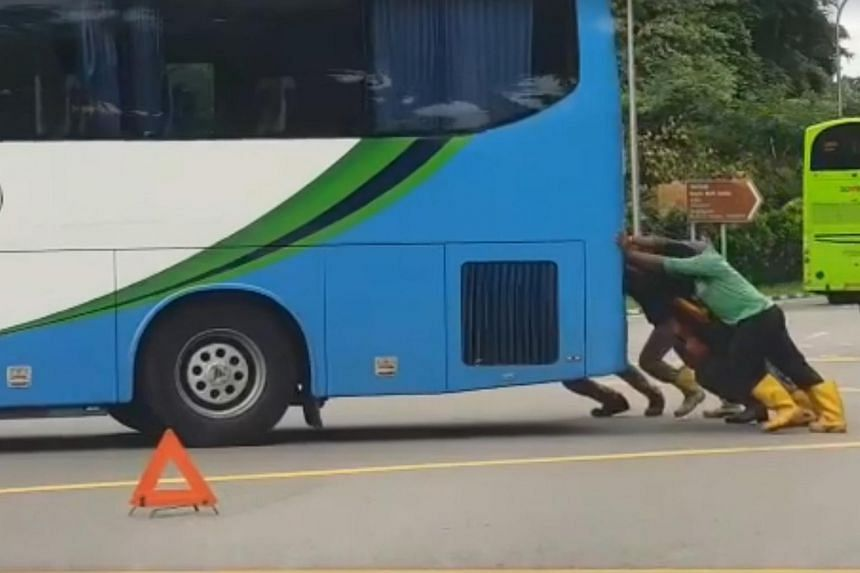 A video shared on Facebook showed the workers working as a team to push at the rear end of the bus until it was successfully moved out of the junction.
