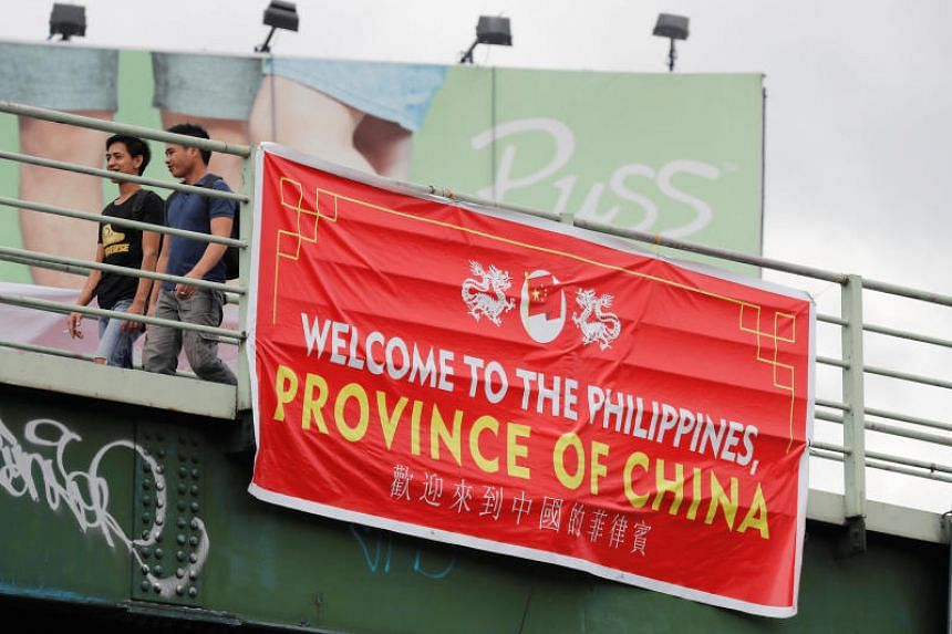 """A banner reading """"Welcome to the Philippines, Province of China"""" is displayed on an overpass along the C5 road intersection in Taguig, Philippines, on July 12, 2018."""