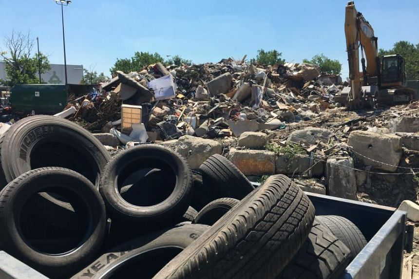 Waste is piled up at the District of Columbia's Fort Totten Transfer Station in Washington, DC, on July 10, 2018.