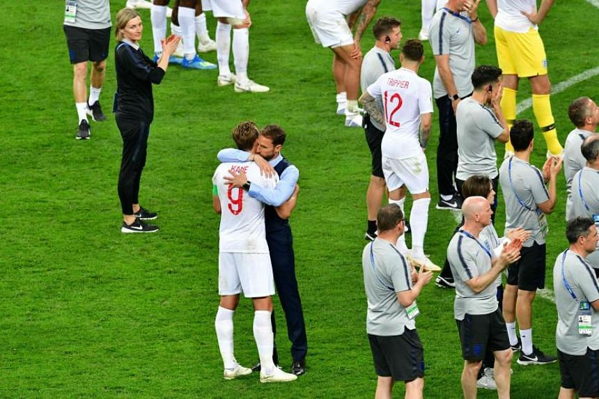 England's forward Harry Kane (left) and England's coach Gareth Southgate (second left) react after losing the 2018 World Cup semi-final football match between Croatia and England at the Luzhniki Stadium in Moscow, on July 11, 2018.