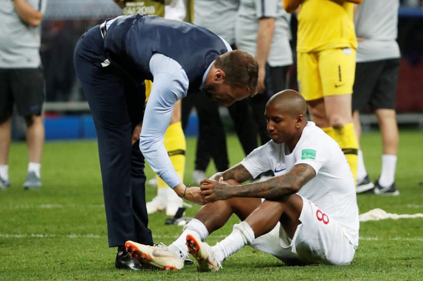 England manager Gareth Southgate consoles Ashley Young after the match between Croatia and England at the Luzhniki Stadium in Moscow, on July 11, 2018.