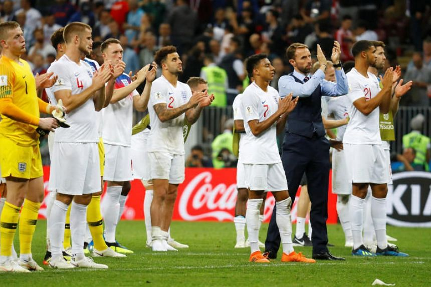 England manager Gareth Southgate and his players applaud fans after the match between Croatia and England at the Luzhniki Stadium in Moscow, on July 11, 2018.