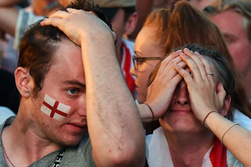 England fans react to Croatia winning the FIFA World Cup 2018 semi final between England and Croatia at a public viewing in London, Britain, on July 11, 2018.