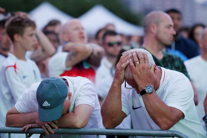 England fans watch the match between Croatia and England at Nottingham Castle in Nottingham, Britain, on July 11, 2018.