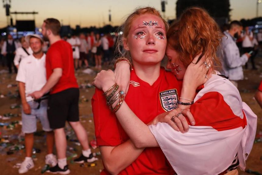 England supporters react at an outdoor screening in Hyde Park in central London as England lose the 2018 World Cup semi-final against Croatia in Moscow, on July 11, 2018.